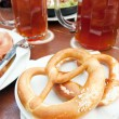 Bretzel and beer — Stock Photo