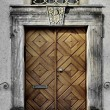 Old, massive, stamping door — Photo