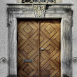 Old, massive, stamping door — Stock Photo