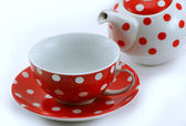 Cup and teapot of red color — Stock Photo