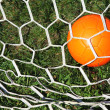 Stock Photo: Soccer ball in net