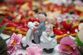 Newlyweds on the cake — Stock Photo