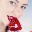 Woman with heart shaped lollipop — Stock Photo #18343861