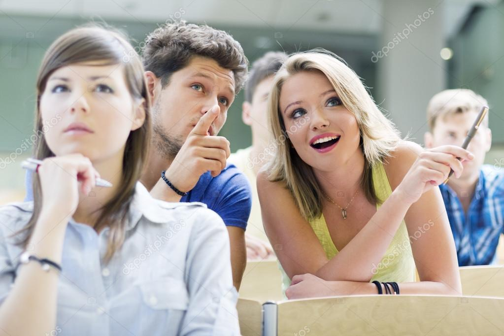 Group of university students concerned with a lecture — Stock Photo #18342123