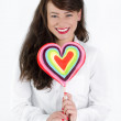 Woman with heart shaped lollipop — Stock Photo #18474771
