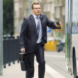 Businessman using public transportation - Stock Photo