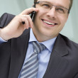Businessmusing mobile phone — Stock Photo #18678687