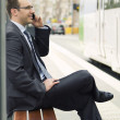Businessman on bus stop — Stock Photo