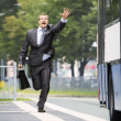 Businessmtrying catch bus — Stock Photo #18678839