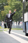 Businessman trying catch the bus — Stock Photo