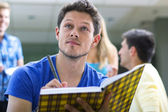 Student writing in notebook — Stock Photo