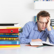 Overworked young man - Stock Photo