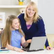 Mother and daughter with laptop — Stock Photo