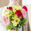 Man giving bunch of flowers — Stock Photo