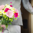 Mwith bunch of flowers — Stock Photo #27047361