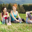 Girls resting after exercising — Stock Photo