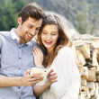 Smiling couple with tablet — Foto de Stock