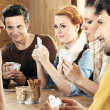 Stock Photo: Friends playing card game