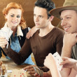 Friends playing card game — Stock Photo