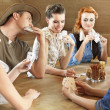 Friends playing card game — Stock Photo #27049549