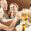 Friends drinking beer — Stock Photo #27049585