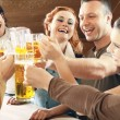 Friends drinking beer — Stock Photo