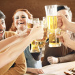 Friends drinking beer — Stock Photo #27049621