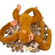 Pile of coins and a monkey — Foto Stock