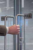 Pull open the door — Stockfoto