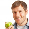 Young man with apple — Stock Photo #18720325