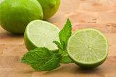 Limes with mint — Stock Photo