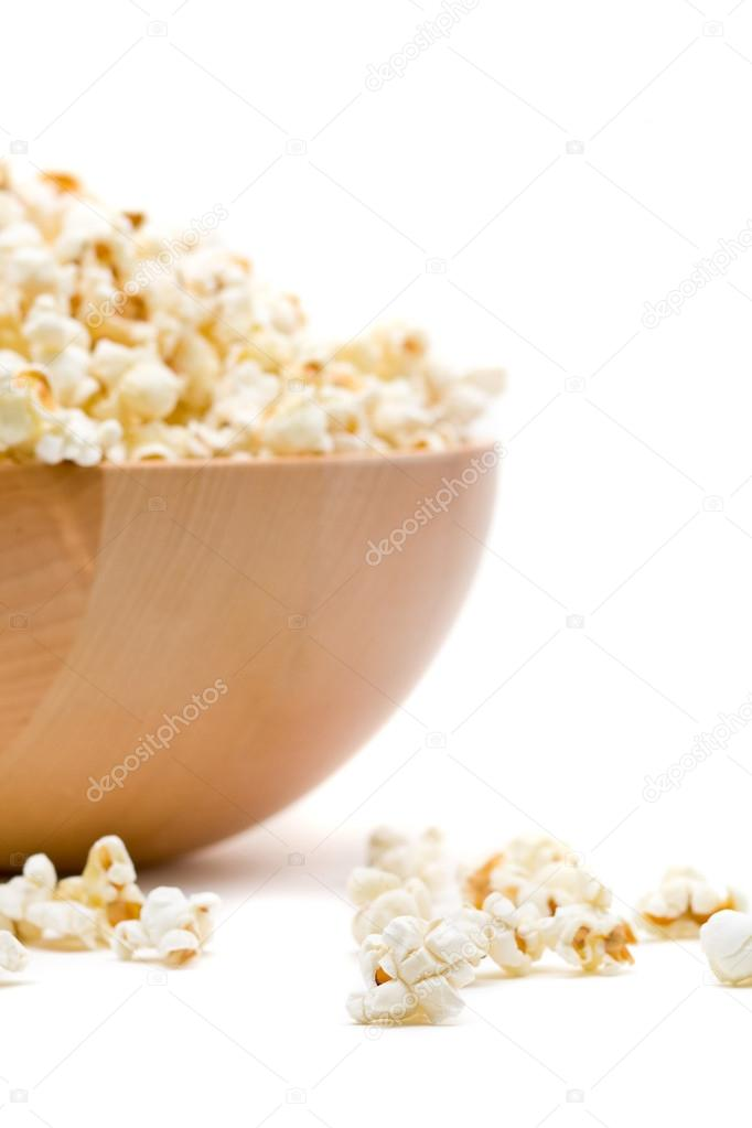 Delicious popcorn in bowl over white background — Stock Photo #18728943