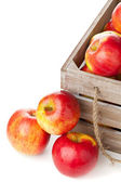 Organic apples in wooden box — Stock Photo
