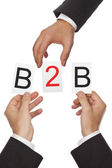 Hands putting the letters for B2B - business to business - together — Foto de Stock