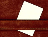 Leather with vintage label — Stock Photo