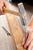 Hammer and nail woodworking — Stock Photo