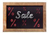 Sprzedaż kredy pisać ze znakami procentu na tablicy — Zdjęcie stockowe