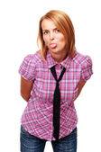 Young casual girl shows her tongue — Stock Photo