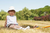 Little adorable girl in the park — Stock Photo