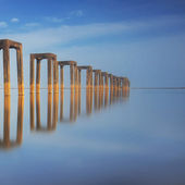 Reflection of an abandoned jetty — Stock fotografie