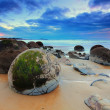 Stock Photo: Cloudy Sunrise at Moeraki Boulders, New Zealand
