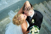 Bride and groom on the background of the stairs — Stock Photo