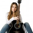 Beautiful girl with a guitar — Stock Photo