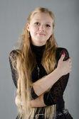 Beautiful young girl in a black dress — Fotografia Stock