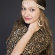 Beautiful young girl in a leopard print dress — Stock Photo