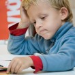 Child engaged in creative work — Stock Photo #24985131