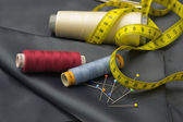 Thread Spools, Pin and Yellow Measuring Tape. — Stock Photo