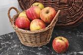 Wicker Basket of Ripe Apples — Stock Photo