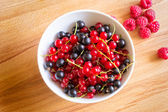 Raspberry, Red and Black Currant on Wood Background. — Stock Photo