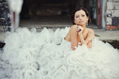 Smiling bride in a wedding dress — Stock Photo